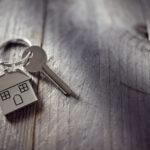 House key on a house shaped keychain